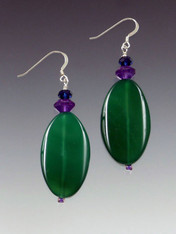 These earrings will go with all the new colors and brighten your look at the same time. Vivid green agate slices topped with amethyst and deep indigo Swarovski rondels and a sterling silver earwire. 1-3/4""