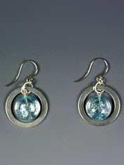 """Make a dramatic statement with these dichroic* Venetian glass disc earrings with sparks of iridescent pale blue and silver suspended in a .99 sterling ultraplate hoop with sterling silver earwires. 1"""""""