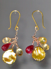 This smashing pair of earrings features a delightful dangle of precious rubies, citrine, and golden petal pearls. 1-1/4""