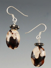 Rare Australian fossilized peanut wood topped with a wood/bone dangle.