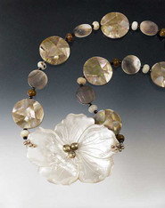 This statement necklace  features alternating mosaic shell and mother of pearl discs and mocha opal rondels.  20""