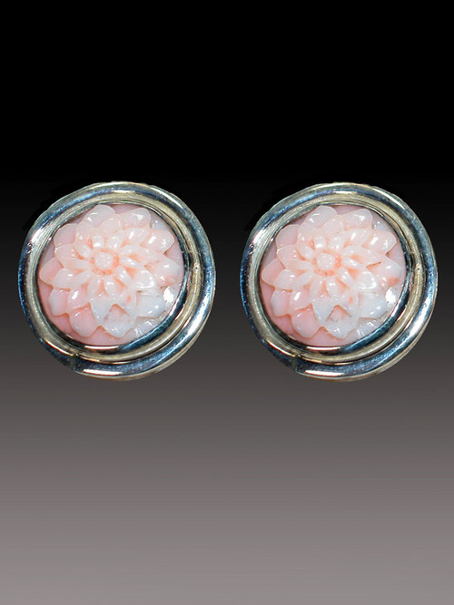 These Amy-Kahn Russell clip earrings feature hand-carved pale pink angelskin coral flowers bezel set in sterling silver