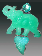 This Amy Kahn Russell pin / pendant features a bright green hand-carved chrysophrase elephant!
