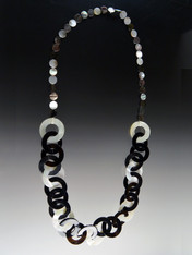 "This lightweight on trend necklace features luminous natural Makabibi shell, black horn, and mother-of-pearl linked circles in tones of black, white, and gray with smaller natural mother-of-pearl discs around the neck for extra comfort.  22""  Only 6 available."