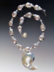 """This spectacular 20"""" necklace features gleaming opulent taupe/gray baroque pearls with a magnificent 3"""" pale blue and white Nautilus Shell sterling silver pendant custom ordered from Bali."""
