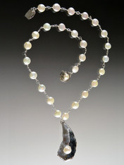 """This spectacular necklace features silver-wire wrapped grade AAA white freshwater pearls and a sterling silver Oyster shell with a  perfect oyster pearl inside. Each unique pendant is hand-crafted in Bali. Necklace 18"""" Pendant 2"""""""