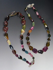 Tourmaline has skyrocketed in price in the past few years.  I have available two strands of smooth watermelon tourmaline pubble shapes ranging from deep wine to green to strawberry each hand-knotted with silk.  19""