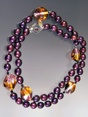 "This spectacular long necklace features deep wine pearls, imited edition tri-color transparent amber, amethyst, purple, sterling silver Venetian three dimension sasso* beads, garnet Swarovski crystals and a custom garnet sterling clasp so you can wear it long or double.  Easy to pair with other pieces in the collection.  Super elegant and perfect tones for right now.  32""  ONLY TWO!"