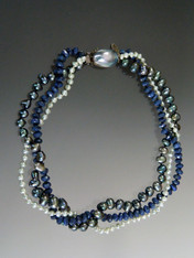 "Blue is in style all year and this fall it's one of the top colors -denim, twilight, sky blue.  If you love blue this necklace is for you.  This multi-strand torsade features hand-knotted silk dolomite, light blue and dark blue pearls, held together with a custom clasp ordered 12 years ago featuring a huge blue mabe pearl set in patterned sterling silver with a safety clasp.  20""  ONLY TWO!"