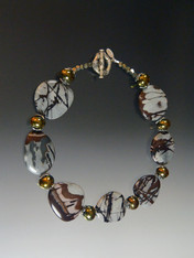 "If you like large statement pieces straight from nature with a global vibe this is for you!  This dramatic collar features richly patterned outback jasper from Australia with Greek ceramic stations and Bali sterling beads and toggle clasp.  19""  Very special."
