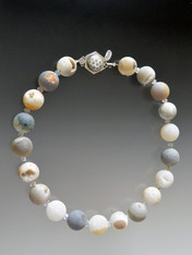 This all natural silk hand-knotted Brazilian druzy collar features gumball shaped agate with glimpses of druzy fissures, a neutral palette in tones of gray, white, pale rose that blend with any ensemble all year round, and a rare dotted sterling clasp.