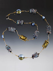 "A statement rope with gold that glitters and neutral tones right for now!      Clusters of iridescent blue peacock biwa pearls     14K curved tubes     24K Swarovski crystals     Custom designed and imported from Italy 24K gold and silver foil Venetian glass in gold, silver, bluino, khaki and black      Tiny clasp that gives you the option of wearing this 35"" rope double or single     Create a special look day or night"