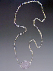 Toss on this shining natural druzy pendant set in sterling silver suspended from an intricate Duraplate silver chain.