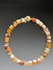 This one-of-a-kind ethically sourced Brazilian step cut quartz necklace is a medley of butterscotch, terracotta and peach tones with a vintage bakelite clasp.