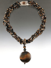 """Wear adramatic statement necklace that's perfect for right now and for all the season's colors. Six strands of brown multi agate, a large removable brown agate disc pendant, and a custom pietersite sterling clasp are all you need to pair with your favorite outfit. 22"""""""