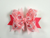 "1.5"" Burlap Ribbon Bow with Hot Pink and Lt. Pink Glitter Tags on an Alligator Clip."