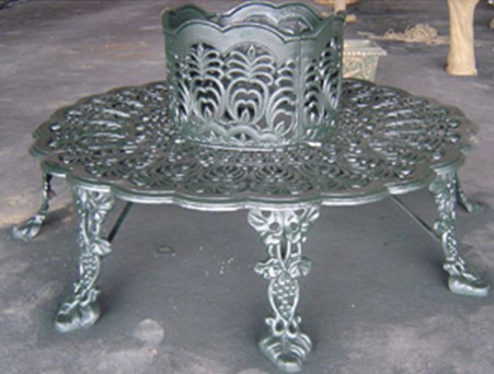 Newly produced cast iron garden tree bench. This is one of our classical designs that we have produced over the years and have decided to reintroduce it to the market. Since the material is cast iron you can paint it almost any color you prefer, allowing you to match any existing color schemes. Measures: 69 wide.