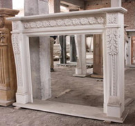 HAND CARVED MARBLE FIREPLACE MANTEL, WHITE MARBLE WITH FLORETTES AND ACANTHUS LEAF CARVINGS Measures: 47.5 tall x 59.25 wide. Opening Measures: 35.25 tall x 39 wide.  Before purchasing, please contact us for availability and a shipping quote: (410) 745-3700.