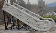 MASSIVE MARBLE STAIRWAY HANDRAIL, 195 INCHES LONG WITH CHERUB AND FLORAL CARVINGS.