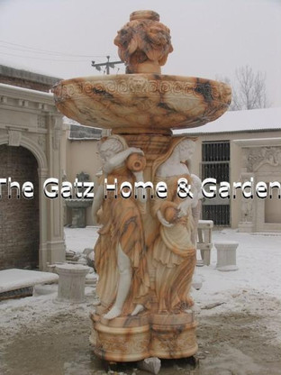 Marble fountain with marble coping Measures: 10 feet high x 16 feet in diameter coping is 20 inches high