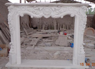 Marvelously crafted French Rococo design marble fireplace mantel. Dimensions: L:63.8 x H:48.4 x D:11.8, Opening is 42 wide x 36 tall.  This mantel is all hand carved and has excellent detail throughout. Floral relief carvings down the legs with acanthus relief on the bottom of the legs. The center has the traditional swag firebox opening with wonderful carvings throughout.  Before purchasing, please contact us for availability and shipping quote.