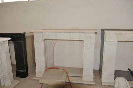 Hand carved fireplace mantel in White marble. Modern design with minimalistic carvings. Also available in Gray, Black granite, and off White marble.  Dimensions:  Whole size is L: 61.25 x H: 49 x D: 8, Opening is L: 37.5 x H: 39 (Inches).   Before purchasing, please contact us for availability and shipping quote.