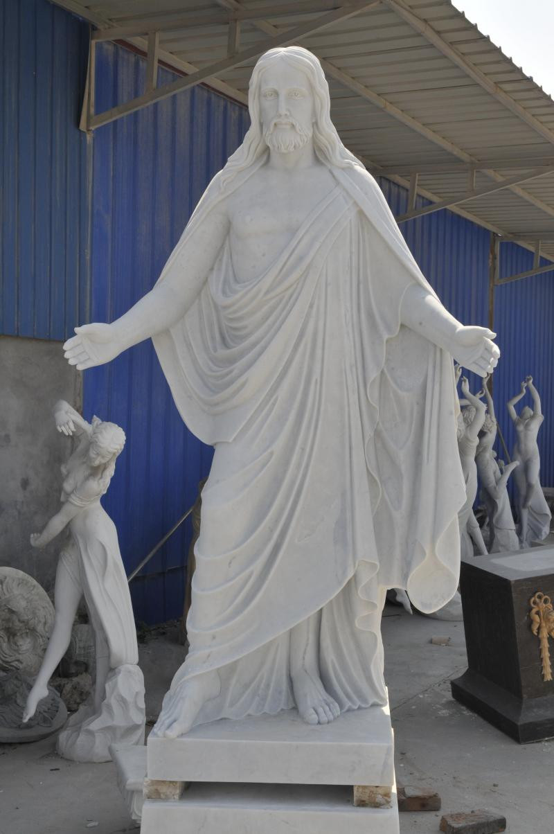 White Marble Statue : Marble statue of jesus with hands out on pedestal nice for