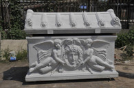 Hand Carved Marble Monument depicting 2 angels holding an angel's head with wings. Lion heads decorate the top.  Before purchasing please contact us for availability and for a shipping quote.