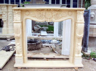 HAND CARVED MARBLE FIREPLACE MANTEL WITH ROSETTE CARVINGS, SHOWN IN BEIGE  H: 49 x W: 59 x D: 12 Opening: H: 40 x W: 39.  Before purchasing, please contact us for availability and shipping quote.