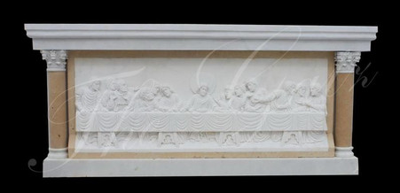 All hand carved marble altar. This one has a relief depiction of the lat supper but we can produce any design you prefer. All made from solid blocks of marble. Measures 42 tall x 96 wide x 36 deep.