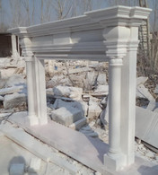 "Hand carved marble fireplace mantel all carved from white marble. Very simple but elegant Greco Roman design with columns and contoured header supporting a tapered mantel shelf. Measures: 76"" wide x 52"" tall. Opening Measures: 36"" tall x 48"" wide."