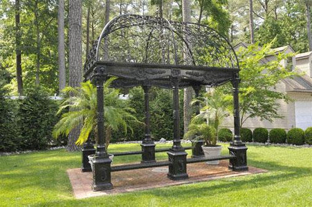 RECTANGULAR VICTORIAN STYLE GARDEN GAZEBO, CAST IRON WITH WROUGHT IRON DOME, BENCH SEATING Measures: 9ft wide x 13ft long x 14ft tall.
