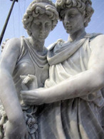 MARBLE MALE AND FEMALE STATUE HOLDING HANDS, GREEK DESIGN  Measures: 67 tall x 32 wide x 23 deep.