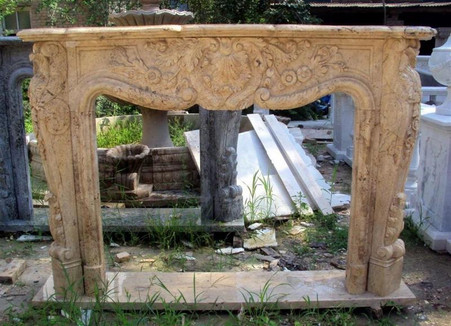 Hand carved French styled fireplace mantel in our Gold Travertine marble. Floral design with lots of great detail throughout. Can be customized to fit your dimensions. Before purchasing please contact us for availability and a shipping quote.  Overall dimensions: 75 x 51 x 14 Opening width: 48 wide x 36 tall Gold Travertine