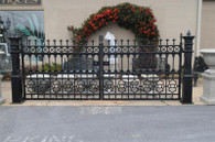 Excellent quality driveway gate in cast iron. Nice design, heavy and solid. We have several sections of fencing available that are compatable with this gate. We can custom build gates and fence for your specific needs. Give us a call to discuss your project. Measurements: Posts 65 high x gate sections are 72 wide. Overall opening 12 feet.