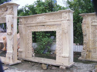 HEAVILY CARVED RENAISSANCE STYLE MARBLE FIREPLACE MANTEL Measures: 71 wide x 51 tall x 12 deep.