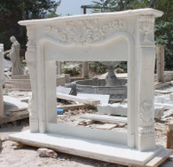 MARBLE MANTEL FIREPLACE INSPIRED BY FRENCH DESIGN IN PREMIUM WHITE Measures: 64.5 wide x 48.5 tall x 12 deep. Opening measures 42 wide x 36 tall.