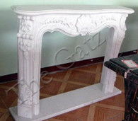 MARBLE FIREPLACE MANTEL WITH CLASSIC FLORAL CARVINGS Measures: 55.2 wide x 43.3 tall x 11.8 deep. Opening measures: 35.5 wide x 31.5 tall.