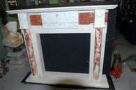 HAND CARVED MARBLE FIREPLACE MANTEL WITH COLUMNS AND CENTER RELIEF. RED AND WHITE MARBLE  Overall: 66 3/8 wide x 57 tall x 14 deep. Opening measures: 40 wide x 38 1/8 tall.