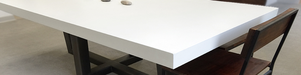 Trueform Custom concrete white kitchen, dining room, conference, living room table. Table with metal base.