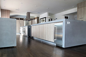 Light blue kitchen concrete countertops with waterfall legs