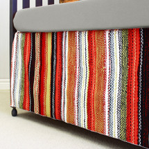 Papaya and grey striped crib dust ruffle