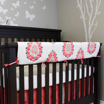 Crib rail protector in coral