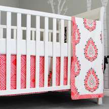 Coral and white crib blanket, sheet, and dust ruffle