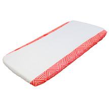 Coral and white change pad cover