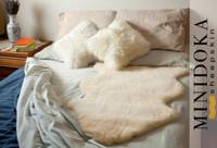Medical sheepskin underlay bed pad. Natural shape pelt.
