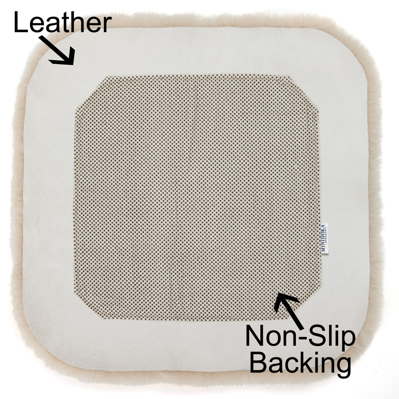 Detail of back with non-slip material sewn securely on middle of pad, leaving space around the edges for the soft leather to conform to the seat.
