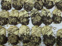 """Our Specialty """"Butter"""" cookies are made with butter and will simply melt into your mouth leaving you wanting another cookie. We lightly drizzle frosting and dip into chocolate and sprinkle with nuts.  Simply Delicious!  You won't find this specialty cookie anywhere else!"""