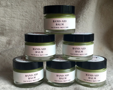 Plantain leaf's analgesic and anti inflammatory qualities bring fast relief and encourage healing of bug bites, cuts, scraps, tattoos,  and other skin irriations. Ingredients: Organic Olive Oil, organic Plantain leaf, organic Lavender flowers, beeswax, organic Lavender essential oil