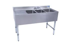 "NEW - Underbar Sink, three compartment, 48""W x 21-1/4""D x 32-1/2""H, 18/304 stainless steel construction, 10"" wide x 14"" front-to-back x 10"" deep compartments, 13-5/8"" stamped drainboard on left OR right, 4-1/2""H backsplash, 4"" O.C. deck mount lead-free faucet (BKD-10-G), stainless steel apron on front & sides, includes basket drains (BKDR-2) & removable overflow standpipes (BK-OT-15075), galvanized steel legs & adjustable side bracing, adjustable high-impact corrosion-resistant feet, NSF"